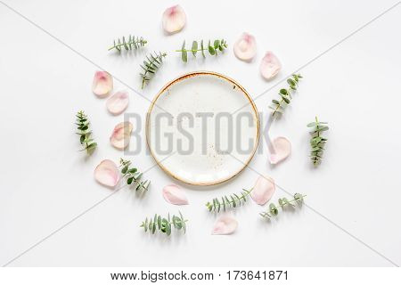 light woman breakfast with spring petals pattern on white table background top view mock up