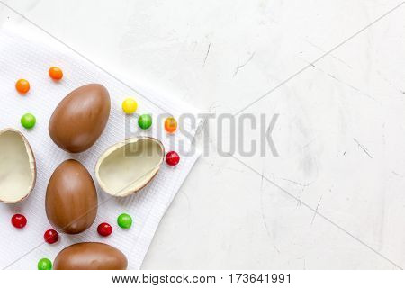 Easter chocolate eggs top view on stone background mock up.