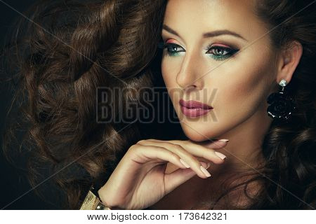 Sexy brunette woman with colorful makeup posing