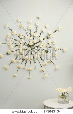 Flower garland on wall background