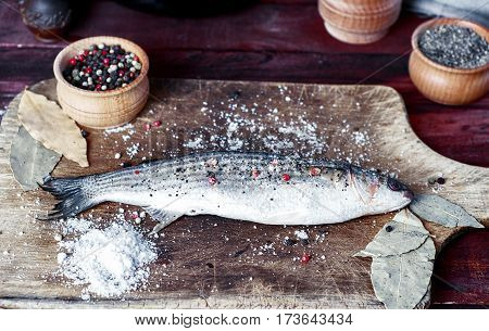 Live fish smelt on a kitchen board with spices