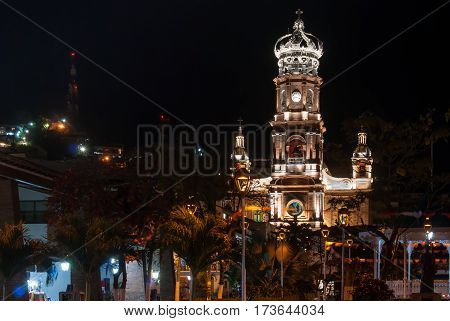 A night shot of the illuminated cathedral in Puerto Vallarta