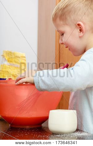 Little Kid Boy Cooking, Making Cake In Bowl