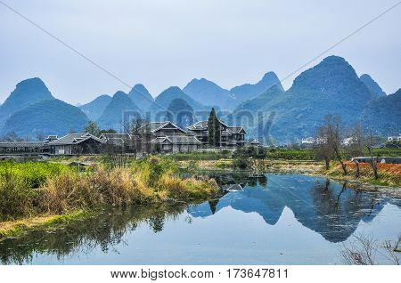 The river and karst mountain scenery in winter