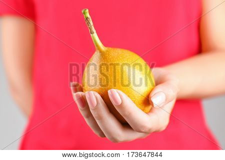 Woman holding passionfruit
