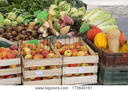 Organic Fruits and Vegetables in Crates at Farmers Market Stall