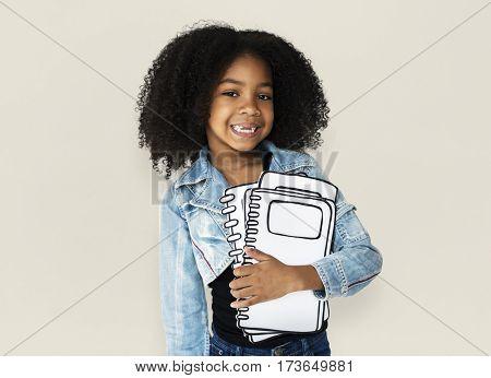 Little Girl Holding Books Smiling