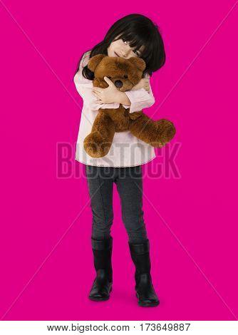 Little Girl Hugging Teddy Bear
