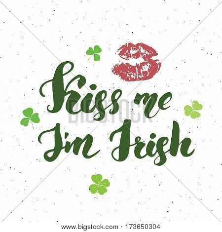 Kiss me I'm irish. St Patrick's Day greeting card Hand lettering with lips and clovers Irish holiday brushed calligraphyc sign vector illustration