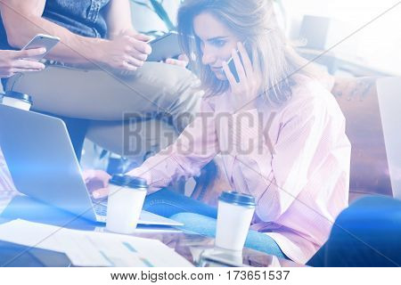 Account manager working process.Young business woman work with new startup project in office.Analyze document, plans.Modern laptop on wood table, papers, documents.Horizontal, blurred, flare