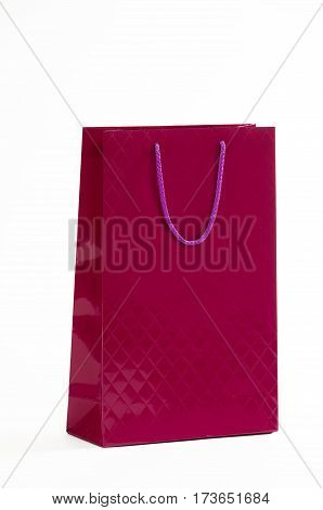 Maroon paper bag on a white background.