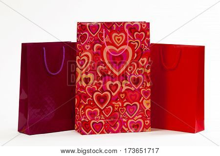 Three red packet with hearts on a white background.