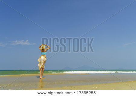 Classy woman on the beach in Vietnam