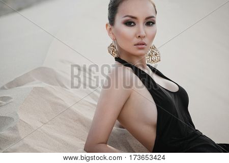 Fashion asian woman model in luxury dress in desert