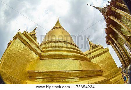 Pan Up of Temple Stupa - Wat Pho Bangkok Thailand beautiful sky