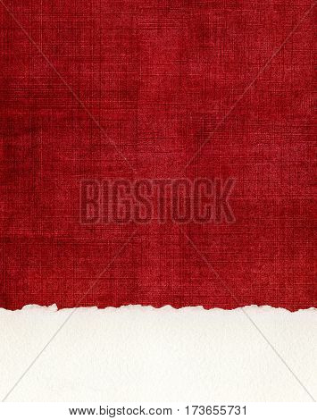 A section of deckled edge paper on a textured red cloth background.