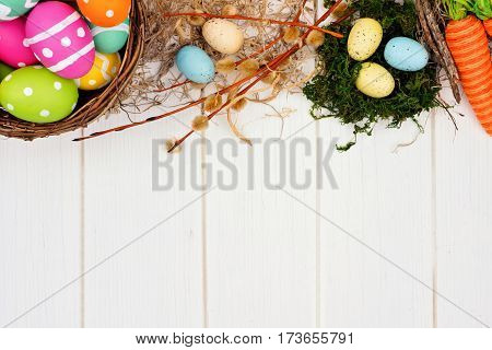 Colorful Easter Or Spring Decor Top Border Over A White Wood Background