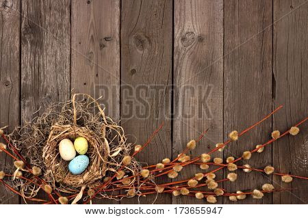 Spring Nest Bottom Border With Willow Branches Over A Rustic Wooden Background