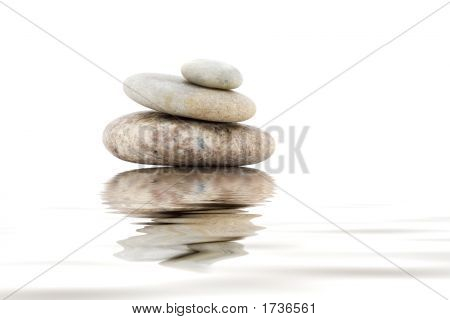Pile Of Balanced Stones On A White Background