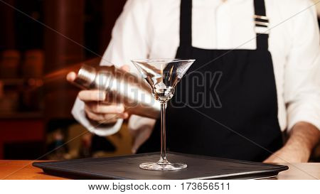 Barman In Making Cocktail At A Nightclub. Nightlife Concept. No Face. Shaking Drink