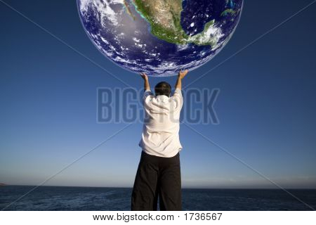 Man Holding The Planet Earth - Science And Enviroment Concept