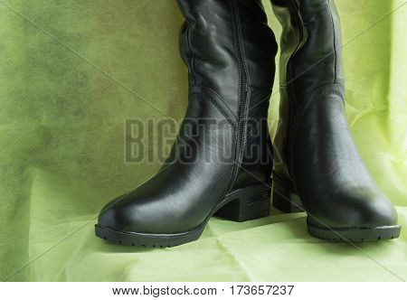 Pair of women's fashion black leather boots.