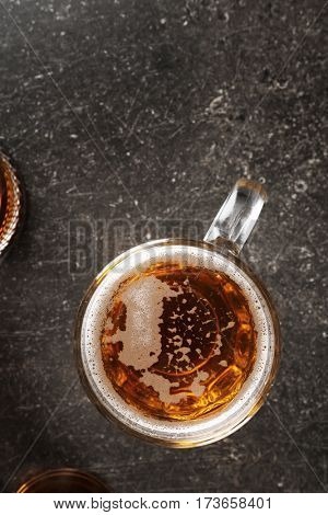 Glass with beer on gray background