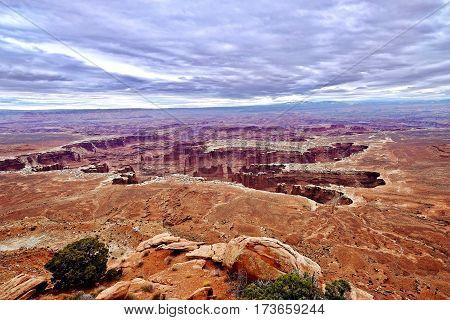 Canyon and hoodoos under storm sky. Canyonlands National Park. Moab. Utah. United States.