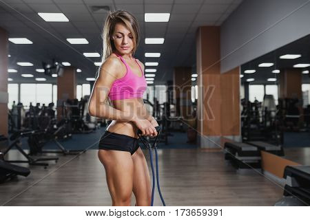 Fitness Beautiful Woman Execute Exercise With Expander In Gym. Stretch Band