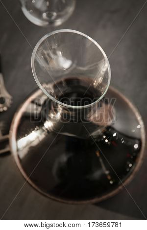 Glass carafe of red wine on gray background