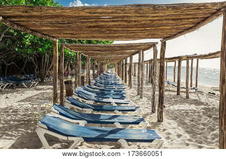 Cayo Coco island, Memories Caribe, Cuba, July 2, 2016, beautiful gorgeous inviting view of Cuban beach with sun sheds, sun beds and people relaxing in background at sunset  time