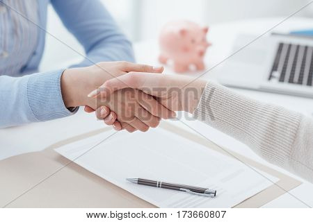 Financial advisor and customer meeting in the office and shaking hands agreement and financial planning concept