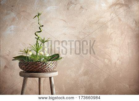 Flower arrangement on color background