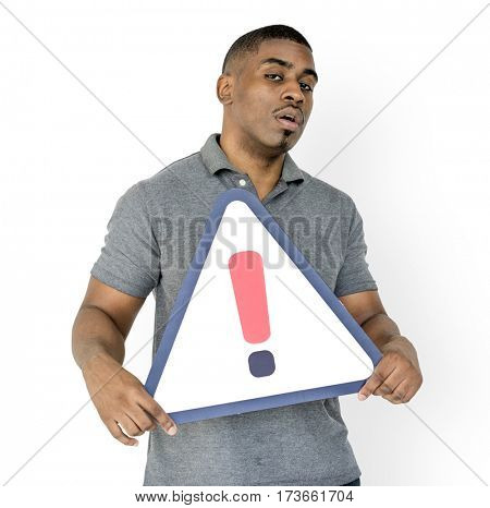 African Descent Man Holding Warning Sign