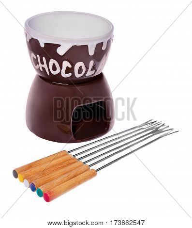 Dish on chocolate fondue with forks to dip fruit in chocolate. The vessel in color brown and white with the word chocolate. Forks with wooden color handles . The composition isolated on a white background with slight reflection.