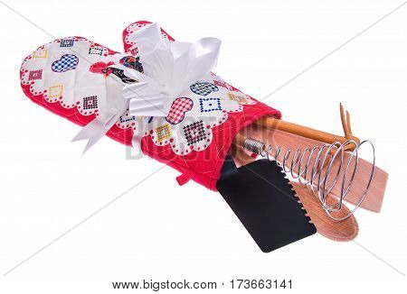 Kitchen tool set: oven glove a wooden spoon roseate spoonbill whisk to froth spade for the dough cake manual wooden mixer. Potholder in white red with the white bow isolated on white background.