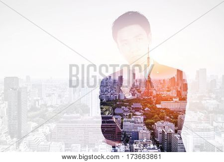 Double Exposure Of  Business Man Thinking Against City