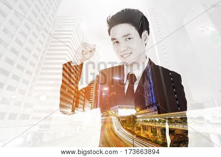 Double Exposure Of Winning Businessman Against City