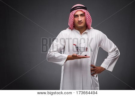 Arab businessman on gray background