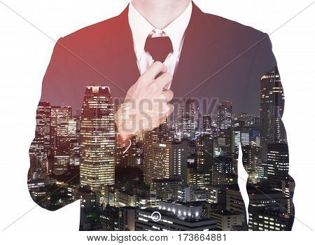 Double Exposure Of Businessman In Suit Tying The Necktie Against City Isolated On White Background
