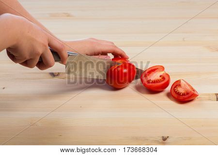 Cutting tomatoes for dishes on the table. Vegetables during the cooking process dishes. Vegetables for healthy eating and dieting.
