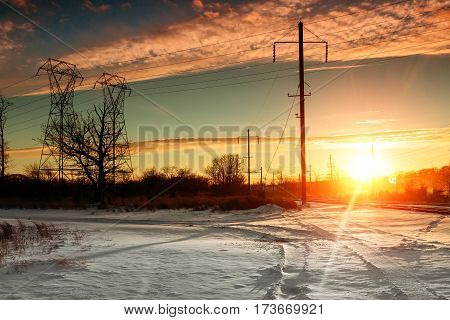 Winter landscape with forest, cliffs and sunset