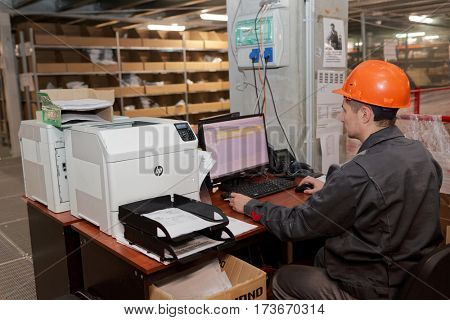 ST. PETERSBURG, RUSSIA - OCTOBER 27, 2016: Worker in the warehouse of Ulmart company. Ulmart is one of the largest Internet retailers in Russia