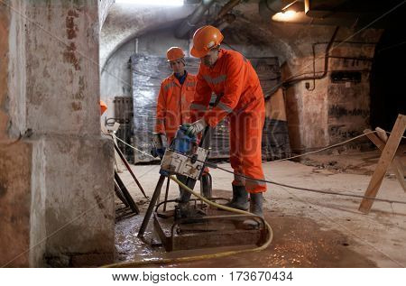 ST. PETERSBURG, RUSSIA - FEBRUARY 15, 2017: Concrete workers in the basement of the Stock Exchange building are working on strengthening the foundation. The building will houses the Museum of heraldry