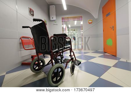 ST. PETERSBURG, RUSSIA - FEBRUARY 16, 2017: Wheel chair in the waiting hall of St. Magdalena children's hospital. The hospital was founded in 1829