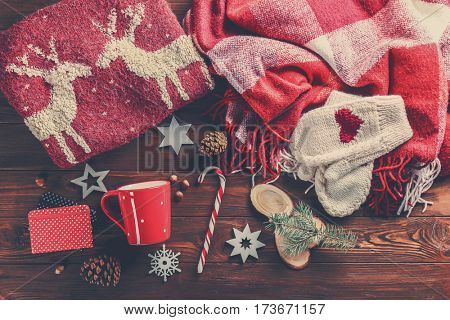 Christmas decorations and clothes on wooden background