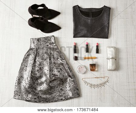 Flat lay set of female clothes on wooden background