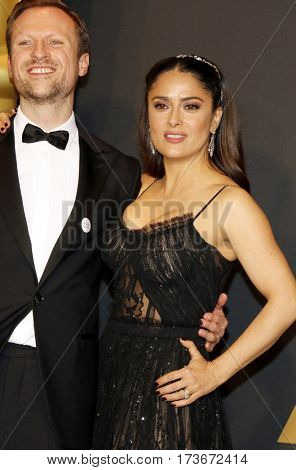 Orlando von Einsiedel and Salma Hayek at the 89th Annual Academy Awards - Press Room held at the Hollywood and Highland Center in Hollywood, USA on February 26, 2017.