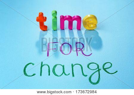 Motivation concept. Phrase TIME FOR CHANGE on blue background