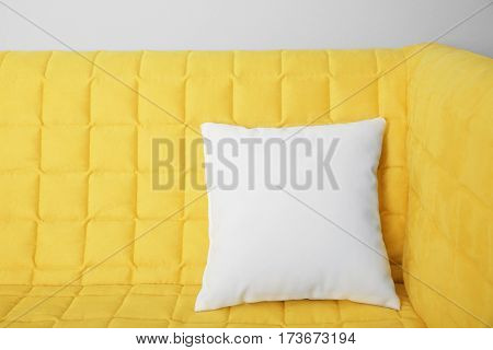 Blank soft pillow on cozy couch
